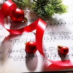 Christmas sheet music with baubles and holly