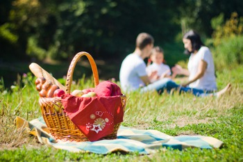 Family enjoying a picnic outside Allan Bank