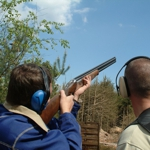 Two men clay pigeon shooting