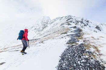 A hiker climbing to the summit of Blencathra