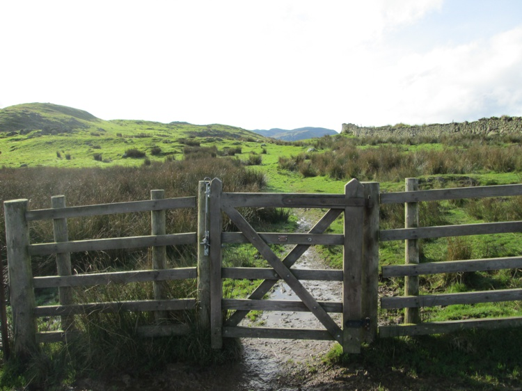 A Gate with Low Rigg in the Distance to the Left
