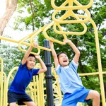 Children swinging on monkey bars